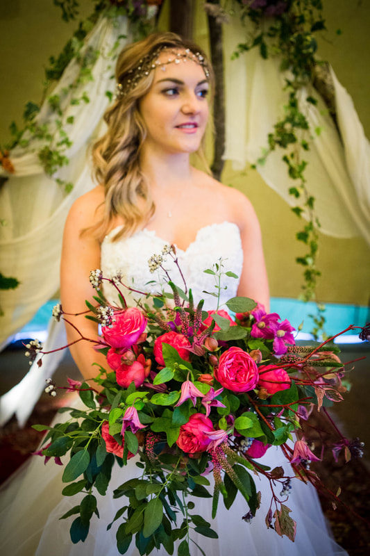 Bride with large pink bouquet