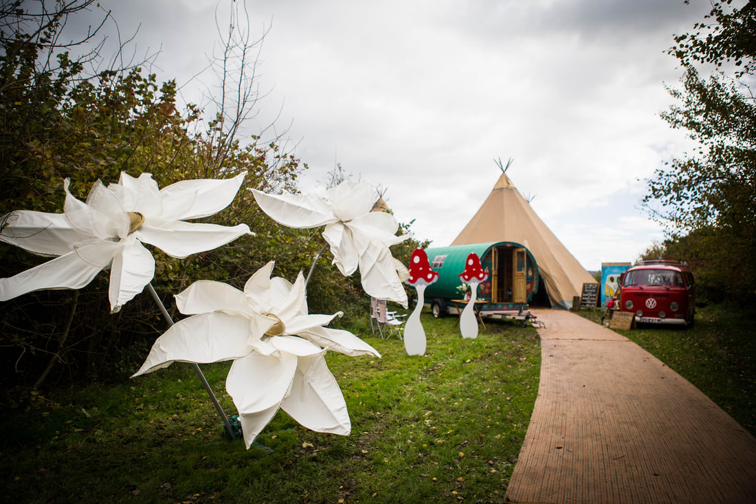 Large white flowers outside of tipis