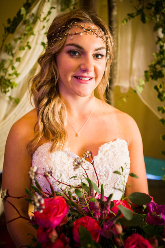 Bride with hair vine and pink bouquet