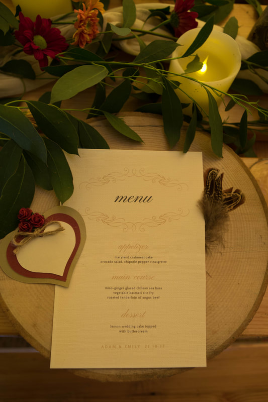 Menu laid out on wooden table setting
