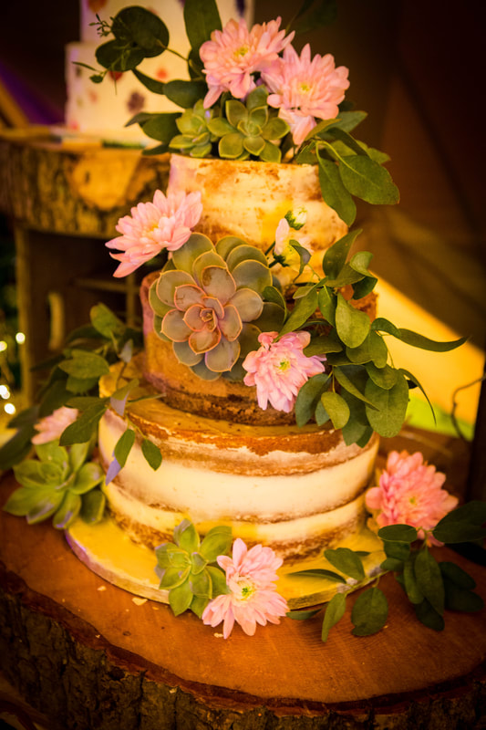 Rustic semi naked wedding cake with fresh flowers